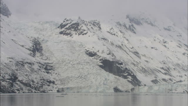 snow blankets glaciers around prince william sound, alaska. - prince william sound stock videos and b-roll footage