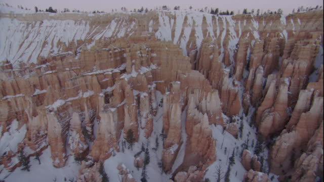 Snow blankets limestone formations in Bryce Canyon, Utah. Available in HD.