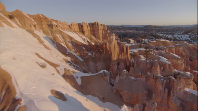 snow blankets limestone formations in bryce canyon, utah. available in hd. - bryce canyon bildbanksvideor och videomaterial från bakom kulisserna