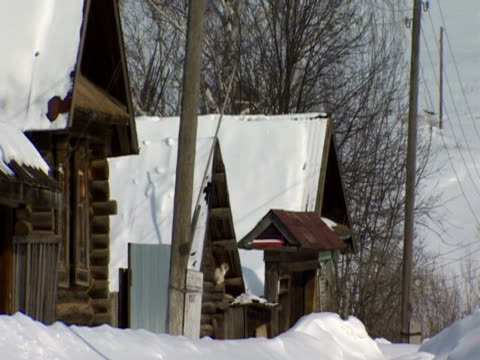 snow blankets roofs in the village of buranovo - bedclothes stock videos & royalty-free footage
