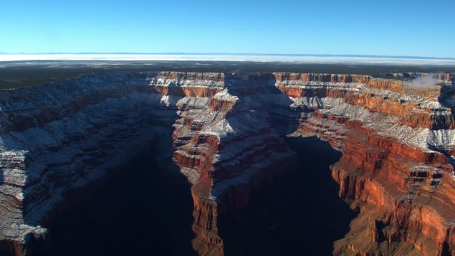 Snow blankets the cliffs of the Grand Canyon.