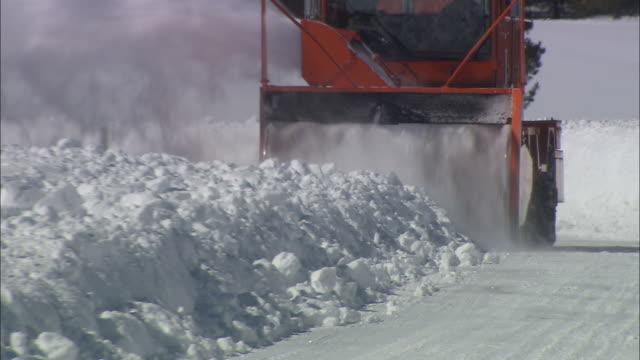 a snow blower clears a road. - グランドティトン国立公園点の映像素材/bロール