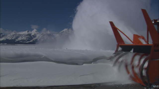 a snow blower clears a road. - plough stock videos & royalty-free footage