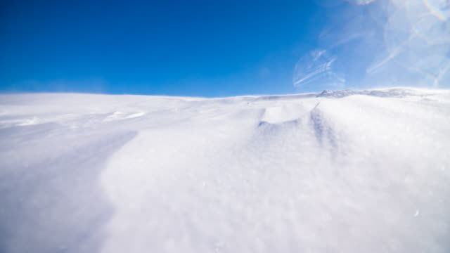 snow blowing in the wind on a clear winter day - mgost stock videos and b-roll footage