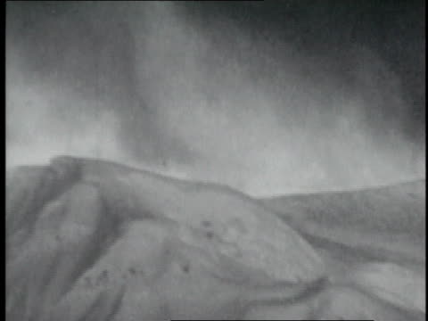 vidéos et rushes de snow blowing off top of mountain peak during storm atop mt everest / nepal - 1952