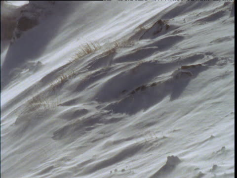 Snow blows down snowy slope, Southern Alps, South Island, New Zealand