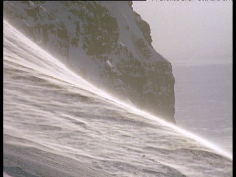 Snow blows over slope, Svalbard