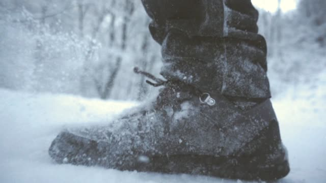 snow boots slow motion - low section stock videos and b-roll footage