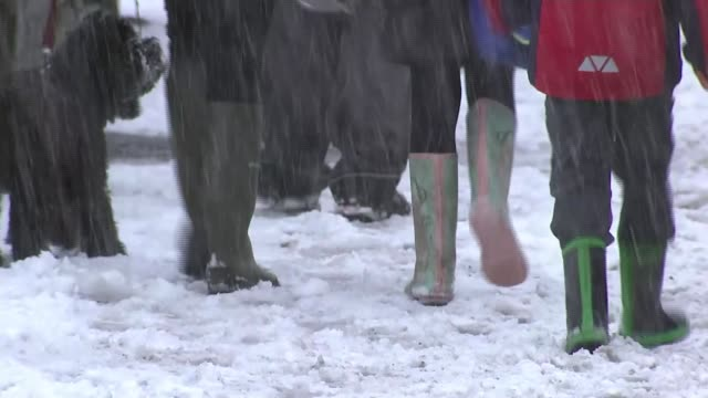 snow brings chaos across the north of england england greater manchester stockport man along street as snow falls legs of people along snowcovered... - stockport bildbanksvideor och videomaterial från bakom kulisserna