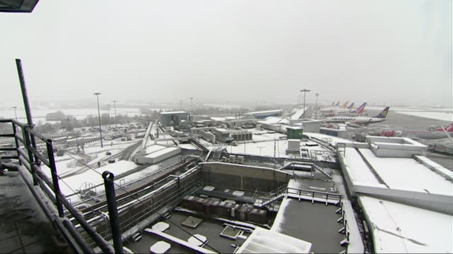 snow brings chaos across the north of england; england: north yorkshire: gargrave: ext / snow on ground reporter to camera west yorkshire: leeds:... - wide stock videos & royalty-free footage