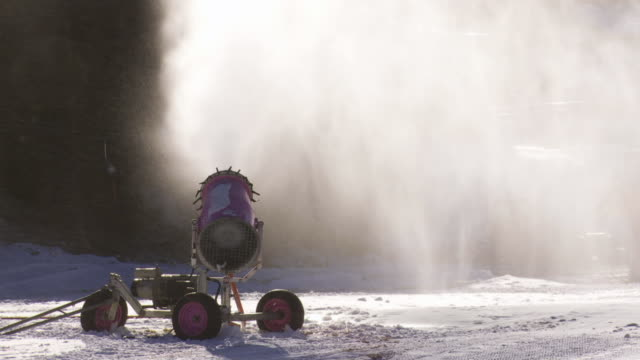snow cannon in the backlit - fake snow stock videos & royalty-free footage