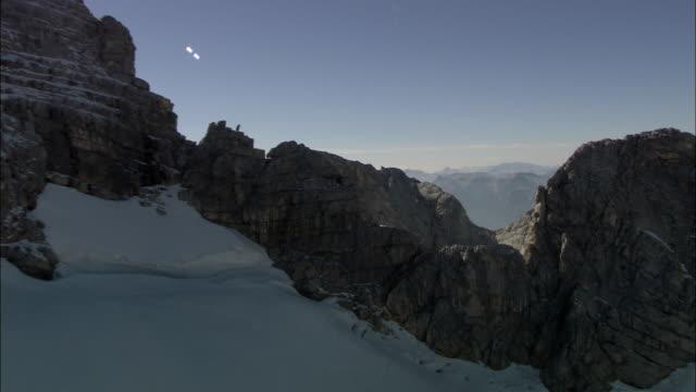 aerial snow capped dachstein range / salzburg, austria - dachstein mountains stock videos and b-roll footage