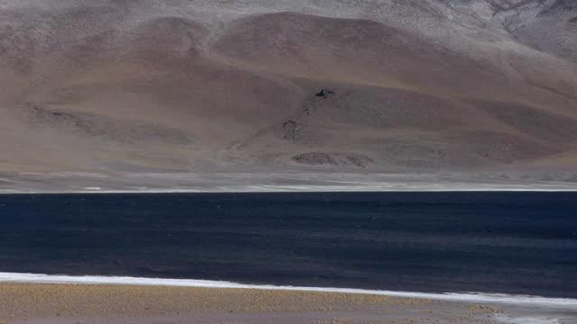 TD TU ZO Snow capped mountain and lake in desert landscape, San Pedro de Atacama, El Loa, Chile