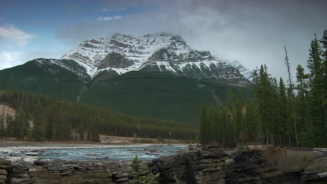 ws snow capped mountain and river above athabasca falls in jasper national park / alberta, canada - athabasca falls stock videos and b-roll footage