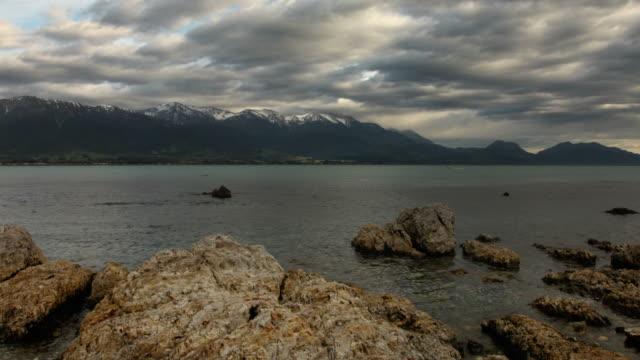 snow capped mountain lake time lapse - kaikoura stock videos & royalty-free footage