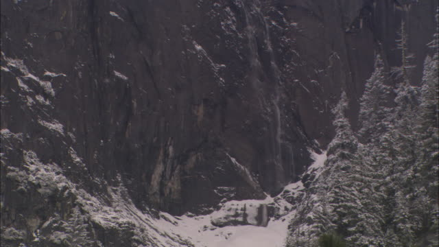 ms, tu, snow capped sheer rock face, yosemite national park, california, usa - rock face stock videos & royalty-free footage