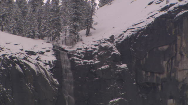 ms, snow capped sheer rock face, yosemite national park, california, usa - rock face stock videos & royalty-free footage