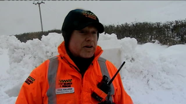 snow causes disruption across much of the uk int rescue vehicle reporter with driver inside bay search and rescue vehicle as along through snow bay... - snow vehicle stock videos and b-roll footage