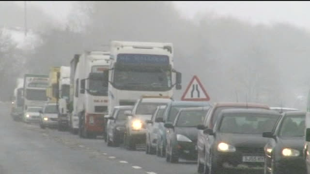 snow causes disruption across much of the uk; scotland: snowing gv vehicles in traffic jam vox pops lorry drivers sot - media interview stock videos & royalty-free footage
