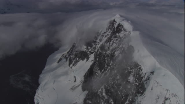 snow clings to a sharp-edged mountain ridge in antarctica. available in hd - bbc stock videos and b-roll footage