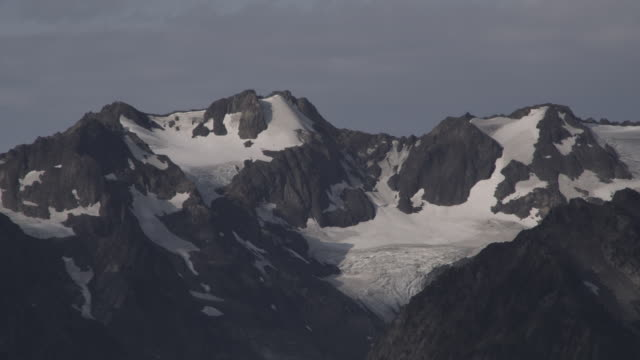 snow clings to rocky mountain peaks in olympic national park. - olympic national park stock videos and b-roll footage