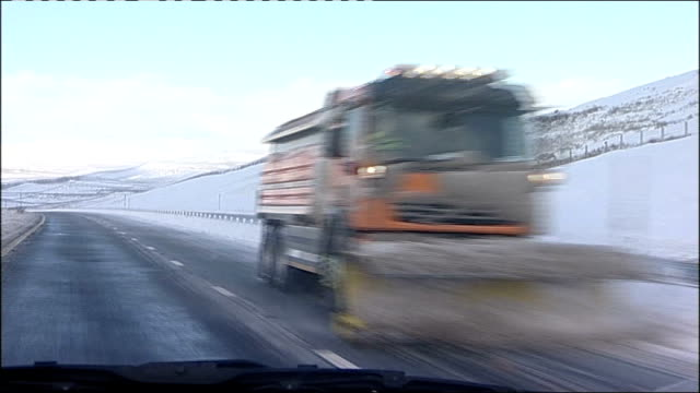 county durham a66 forward in vehicle past snow plough on other side of road inspector ed turner interview as drives along sot - snow vehicle stock videos and b-roll footage