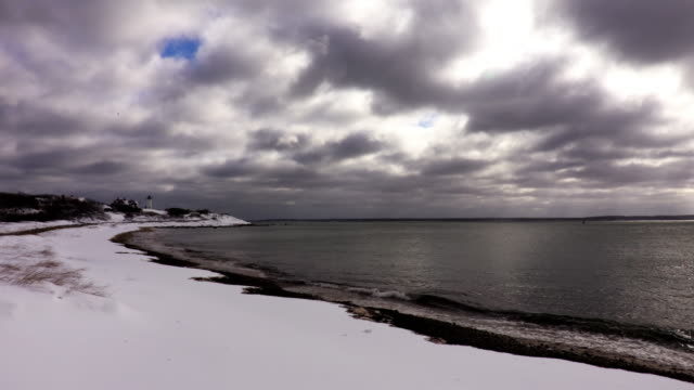 snow covered beach and the nobska lighthouse on cape cod - 1939 stock videos & royalty-free footage