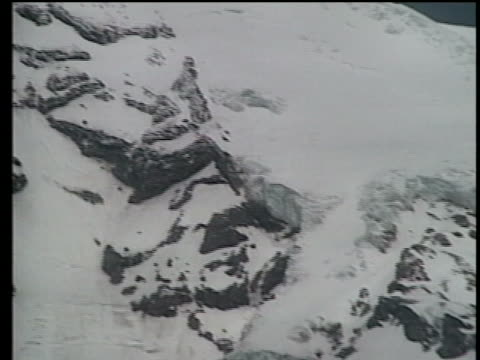 a snow covered mount rainier near seattle washington is seen in three different shots from 1989 - aerial or drone pov or scenics or nature or cityscape stock-videos und b-roll-filmmaterial
