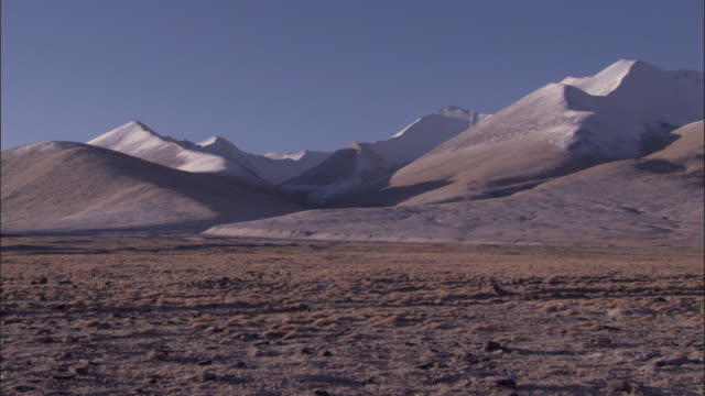 snow covered mountains and plateau, qinghai province, china - plateau stock videos and b-roll footage