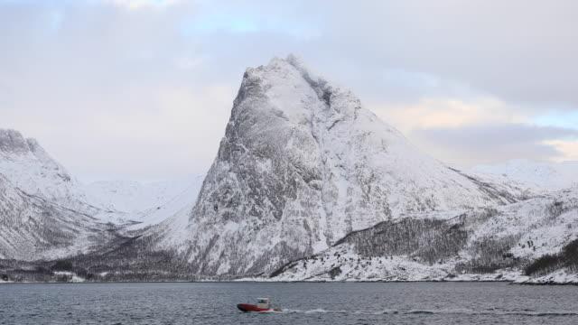 snow covered mountains near to stonglandseidet on the island of senja, norway. - coastline stock videos & royalty-free footage