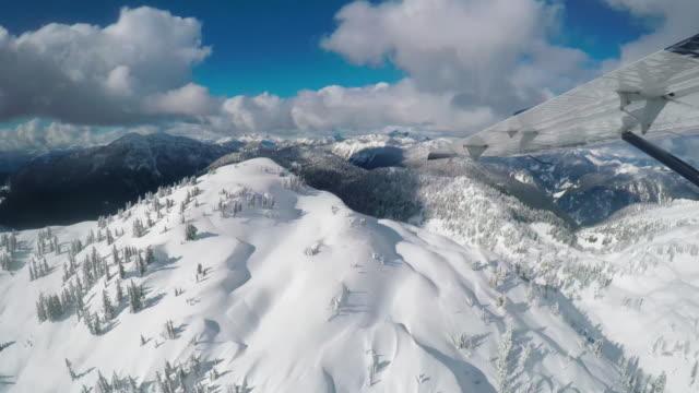 snow covered mountains - 水上飛行機点の映像素材/bロール
