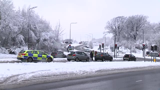 snow covered roads and abandoned cars in kent england kent chatham traffic along road with snowcovered verges and cars abandoned after the heavy... - snowing stock videos & royalty-free footage