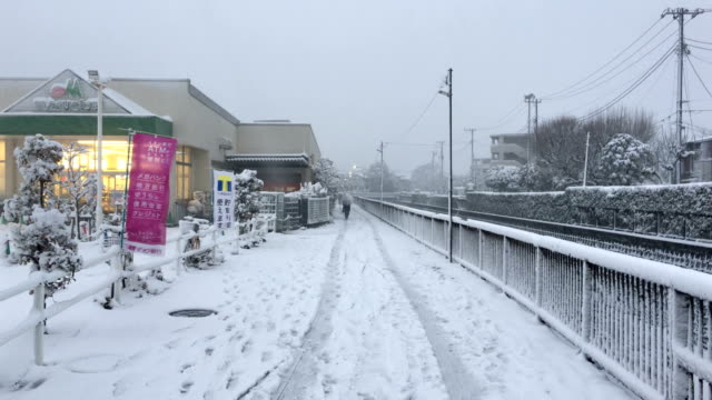 Snow covered streets in Tokyo Japan as rare snow storm hits the city