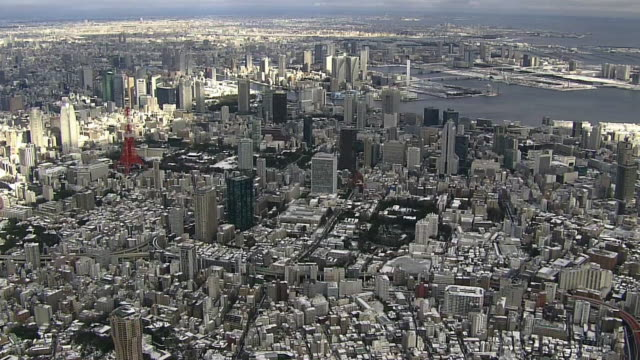 aerial, snow covered tokyo skyline - tokyo bay stock videos and b-roll footage