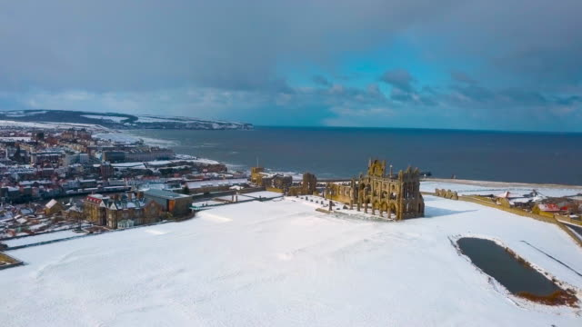 snow covered whitby abbey whitby, north yorkshire - whitby north yorkshire england stock videos & royalty-free footage