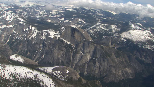snow covers a forested mountain landscape. - mariposa county stock videos and b-roll footage