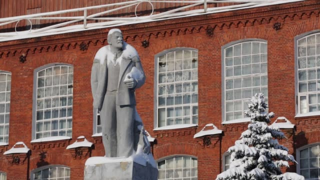 Snow covers a statue of Vladimir Lenin founder of the Soviet Union in Rodniki Industrial Park a former Bolshevik textile manufacturing center in...