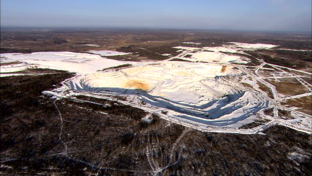 Snow covers an isolated mine in Siberia. Available in HD.