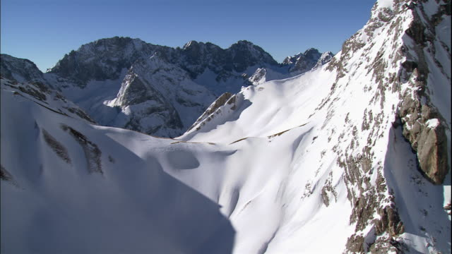 snow covers barren mountain ridges in germany. - bavarian alps stock videos & royalty-free footage