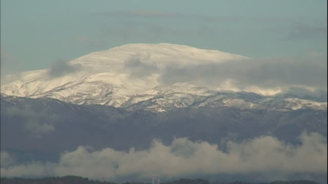 snow covers japan's mt. gassan. - yamagata prefecture stock videos & royalty-free footage