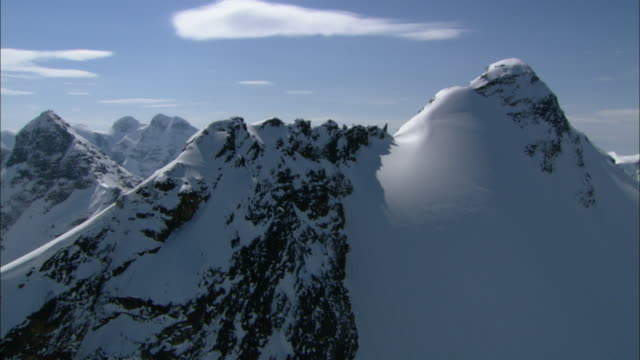 snow covers mountain peaks. - british columbia stock videos & royalty-free footage