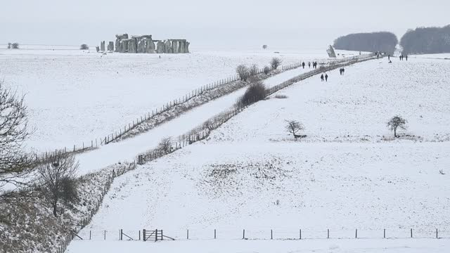 snow covers one of the wonders of the world, stonehenge, in wiltshire, southwest england as a cold snap envelops the uk. - snow stock videos & royalty-free footage