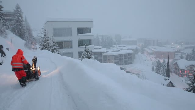 snow covers the congress center during heavy snowfall ahead of the world economic forum in davos switzerland on monday jan 22 2018 - 2018 stock-videos und b-roll-filmmaterial