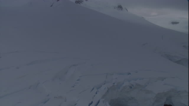 snow covers the fissured edge of an ice shelf in antarctica. - bbc stock videos and b-roll footage