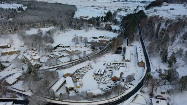 snow covers the hills in allenheads northumberland as snow blankets northern parts of the country residents evacuated from properties in ironbridge... - allenheads stock videos & royalty-free footage