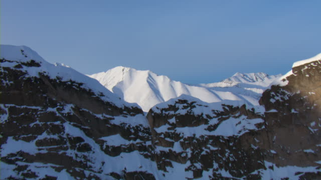 Snow covers the mountains peaks in the Yukon Mountains.