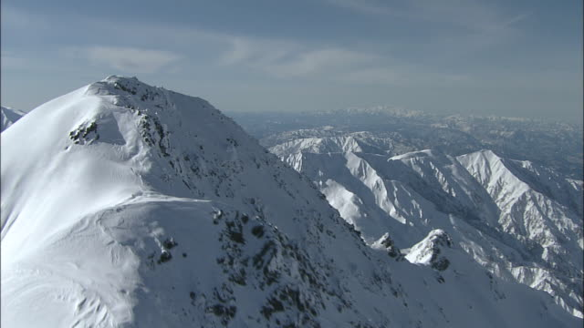 Snow covers the rugged peaks of the Kita Alps and Mt. Tateyama in Japan.