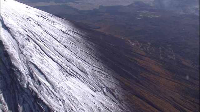 snow covers the summit of mt. fuji. - mt fuji stock videos & royalty-free footage