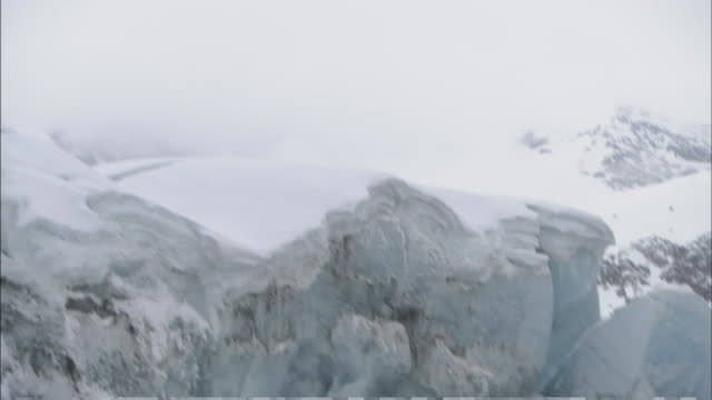snow covers trees and rocks nestle in the mountains of prince william sound, alaska. - prince william stock videos & royalty-free footage