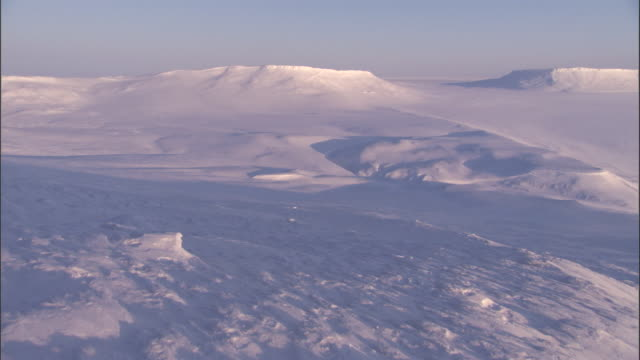 snow covers tundra and sea ice in the arctic. - arctic stock videos and b-roll footage